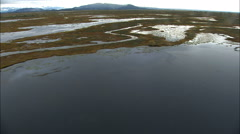 Aerial Alaska melt water delta water tundra Wilderness travel USA Stock Footage