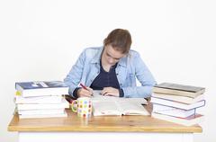 student writes - stock photo