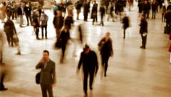 crowd of people walking hectic through city streets. commuters commuting to work - stock footage