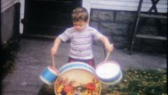 1441 - little boy gets a new drum set - vintage film home movie Stock Footage