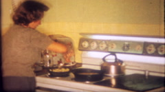 1442 - stovetop cooking with pots and pans - vintage film home movie Stock Footage