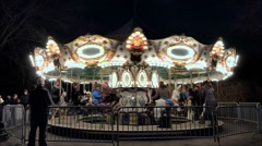 Nightime merry go round carousel, carnival - stock footage