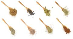 Assortment of spices in wooden spoons Stock Photos