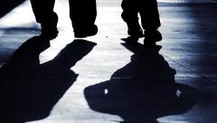 Silhouette of people walking together. shadow of persons Stock Footage