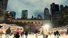 Ice skating rink at bryant park in new york city. people enjoying holidays Arkistovideo