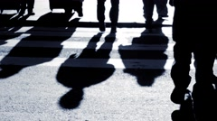 Shadow silhouette of people walking through city. pedestrians background Stock Footage