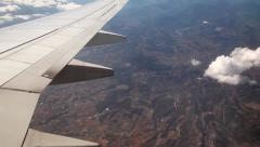 Airplane wing turning during flight, plane wing from inside - stock footage