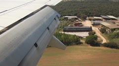 Airplane flying low, plane landing from inside, wing view - stock footage