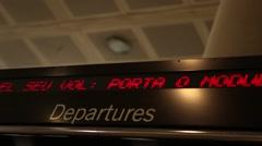 Airport departures board, flight information panel Stock Footage