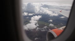 Amazing fly over clouds from airplane, wing and engine, aerial shot Stock Footage