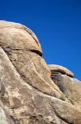 scenic rocks are looking like people in the afternoon light inthe national pa - stock photo