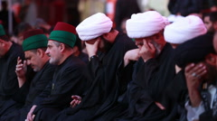 Sheikhs crying for Imam Hussein's calamity inside Hussein's shrine, Karbala 765 Stock Footage