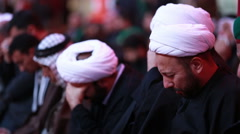 Sheikhs crying for Imam Hussein's calamity inside Hussein's shrine, Karbala 763 - stock footage