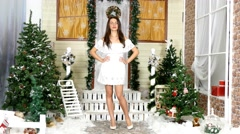 Girl poses on a house porch in studio. Christmas theme - stock footage