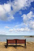 Bench in front of sea Stock Photos