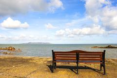 bench in front of sea - stock photo