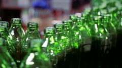 Lot of green olive oil bottles at factory passing by on platform Stock Footage
