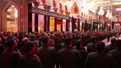 Shrine's servants mourning for Imam Hussein inside Hussein's shrine, Karbala 777 Stock Footage