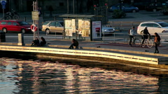 Movements of the city in the golden hour near the sea Stock Footage