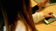 Schoolgirl using her mobile phone in school Stock Footage