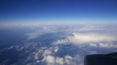Plane flying over beautiful cloud formations Stock Footage