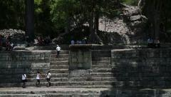 Maya ruins with school kids Stock Footage