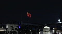 Chinese flag on the roof of the building in the dark Stock Footage