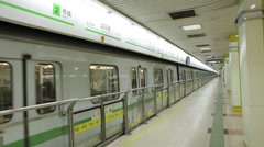 The train departs the station in a Chinese subway Stock Footage