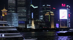 Boat floats on the river against the backdrop of the city at nigh Stock Footage