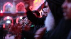 Shrine's servants mourning for Imam Hussein inside Hussein's shrine, Karbala 795 Stock Footage