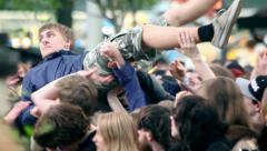 Concert crowd gone mad in a heavy metal concert - Moving head and crowd surfing  Stock Footage