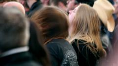 Concert crowd gone mad in a heavy metal concert - Long hairs moving heads Stock Footage