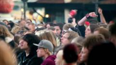 Heavy metal concert crowd gone mad waving hand Stock Footage