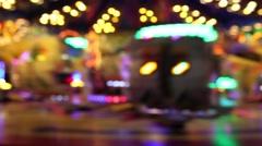 Amusement park carousels (bokeh) Stock Footage