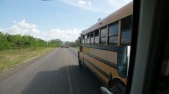 Overtaking schoolbus in Honduras - stock footage