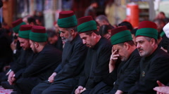 Servants of Imam Hussein's shrine listens to his calamity, Karbala, Iraq 790 - stock footage