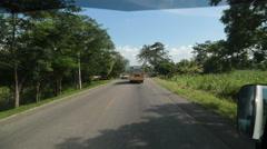 Driving behind school bus Honduras Stock Footage
