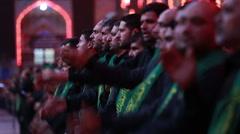Shrine's servants mourning for Imam Hussein inside Hussein's shrine, Karbala 785 Stock Footage