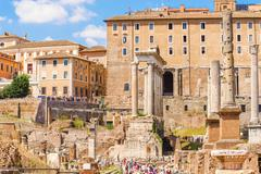 temple of saturn and column of phocas in rome, italy. - stock photo