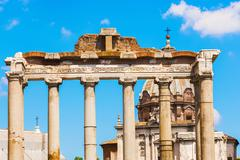temple of saturn in rome, italy. - stock photo