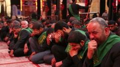 Shrine's servants crying for Imam Hussein inside Hussein's shrine 799 Stock Footage