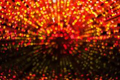Defocused gold and red christmas lights background Stock Photos
