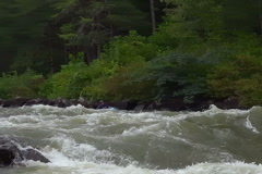 Kayak navigating white water rapids - stock footage