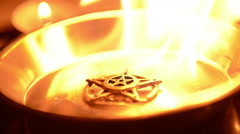 Ancient pentagram burning Stock Footage