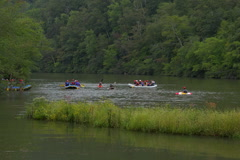 Stock Video Footage of Kayaks and rafters paddle in  quiet river