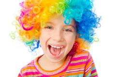 Little girl in clown wig Stock Photos