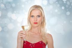 nordic girl holding a glass of wine on a silver gleaming background - stock photo