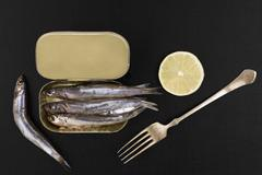 fresh anchovy fish in can. - stock photo