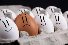 Eggs with smiley faces in eggshell Stock Photos