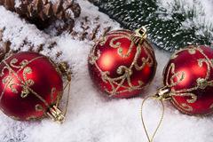 Christmas balls with snow and wood Stock Photos